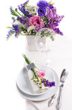 Festive table setting. And decoration with fresh flowers Stock Images