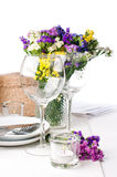Festive table setting. And decoration with fresh flowers Royalty Free Stock Photos