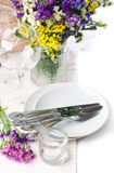 Festive table setting. And decoration with fresh flowers Stock Photography