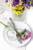 Festive table setting. And decoration with fresh flowers Stock Image