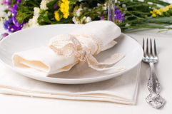Festive table setting. And decoration with fresh flowers Royalty Free Stock Photo