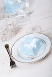 Festive table setting. With blue gift on plate Stock Photos
