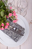 Festive table setting. With roses Stock Photos