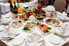 Festive table setting for banquet. Festive table setting for wedding banquet Royalty Free Stock Photo