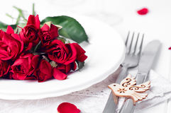 Festive table setting with beige roses, wine glasses, napkins and cutlery, Stock Photos
