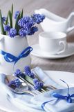 Festive table setting with blue flowers closeup. Vertical Stock Photo