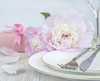 Festive table setting with bouquet of pink and witih peonies, gr Stock Images