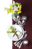 Festive table setting in brown. Festive table setting and decoration with fresh flowers in brown and yellow Royalty Free Stock Photos
