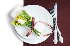 Festive table setting in brown. Festive table setting and decoration with fresh flowers in brown and yellow Stock Images