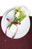 Festive table setting in brown. Festive table setting and decoration with fresh flowers in brown and yellow Stock Photos