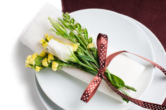 Festive table setting in brown. Festive table setting and decoration with fresh flowers in brown and yellow Royalty Free Stock Photography