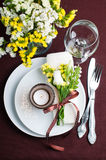 Festive table setting in brown. Festive table setting and decoration with fresh flowers in brown and yellow Stock Photography