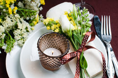 Festive table setting in brown. Festive table setting and decoration with fresh flowers in brown and yellow Stock Photo