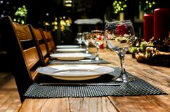 Festive table setting with candles, candlelight dinner stock photos