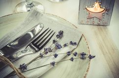 Festive table setting with candles and lavender. Festive table setting at vintage or provence style with candles and lavender. Concept Birthday, Valentine`s Stock Photos