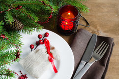 Festive table setting with christmas decorations on wooden table. Xmas holidays background. Royalty Free Stock Photography