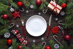 Festive table setting with cutlery and Christmas decorations on Stock Image