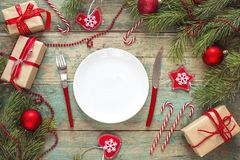 Festive table setting with cutlery and Christmas decorations on Royalty Free Stock Image