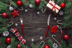 Festive table setting with cutlery and Christmas decorations on. Wooden table. Top view Royalty Free Stock Photos