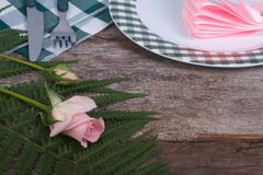 Festive table setting decorated with a pink rose Royalty Free Stock Photo
