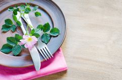 Festive Table setting with pink flowers. Royalty Free Stock Images
