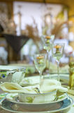Festive table setting detail. Closeup detail of a modern table setting for wedding, birthday or other festive parties and celebrations. Green dishes decorated Royalty Free Stock Photos