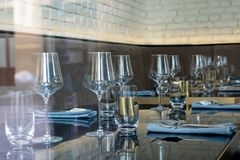 Festive table setting. Empty glasses, cutlery stock images