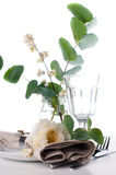 Festive table setting with floral decoration. White roses, leaves and berries on a white background Royalty Free Stock Photography