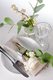 Festive table setting with floral decoration Stock Photos