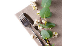 Festive table setting with floral decoration. White roses, leaves and berries on a white background Stock Image