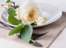 Festive table setting with floral decoration Stock Photo