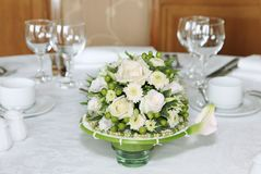 Festive table setting with flowers.  Stock Photo
