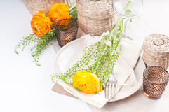 Festive table setting with flowers Royalty Free Stock Image