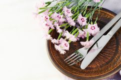 Festive table setting with flowers. Holiday table set for mother`s day or birthday. Selective focus Royalty Free Stock Photo