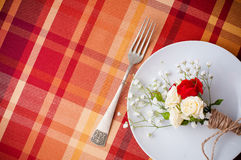 Festive table setting with flowers and vintage crockery Stock Images