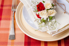 Festive table setting with flowers and vintage crockery Stock Image