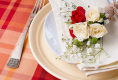 Festive table setting with flowers and vintage crockery Stock Photo