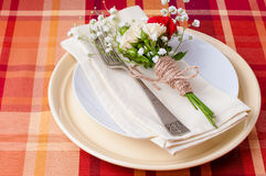 Festive table setting with flowers and vintage crockery Stock Photos