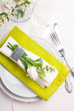 Festive table setting in green. Festive table setting and decoration with fresh flowers in green Royalty Free Stock Image