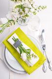 Festive table setting in green. Festive table setting and decoration with fresh flowers in green Royalty Free Stock Photo