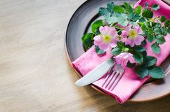 Festive Table setting with pink flowers. Festive Table setting with delicate pink flowers. Holiday Table Set for Mother`s Day or Birthday. Selective Focus Stock Photos