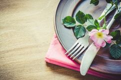 Festive Table setting with pink flowers. Festive Table setting with delicate pink flowers. Holiday Table Set for Mother`s Day or Birthday. Selective Focus Stock Photo