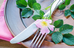 Festive Table setting with pink flowers. Stock Image