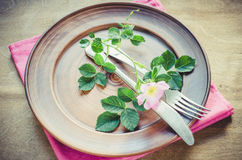 Festive Table setting with pink flowers. Stock Images