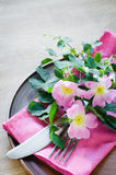 Festive Table setting with pink flowers. Stock Photos