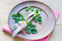 Festive Table setting with pink flowers. Festive Table setting with delicate pink flowers. Holiday Table Set for Mother`s Day or Birthday. Selective Focus Royalty Free Stock Images