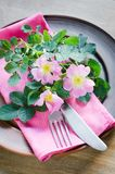 Festive Table setting with pink flowers. Stock Photography