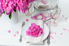 Festive table setting with pink peonies Stock Images