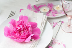 Festive table setting with pink peonies Royalty Free Stock Photography