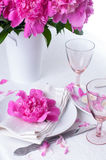 Festive table setting with pink peonies Royalty Free Stock Images